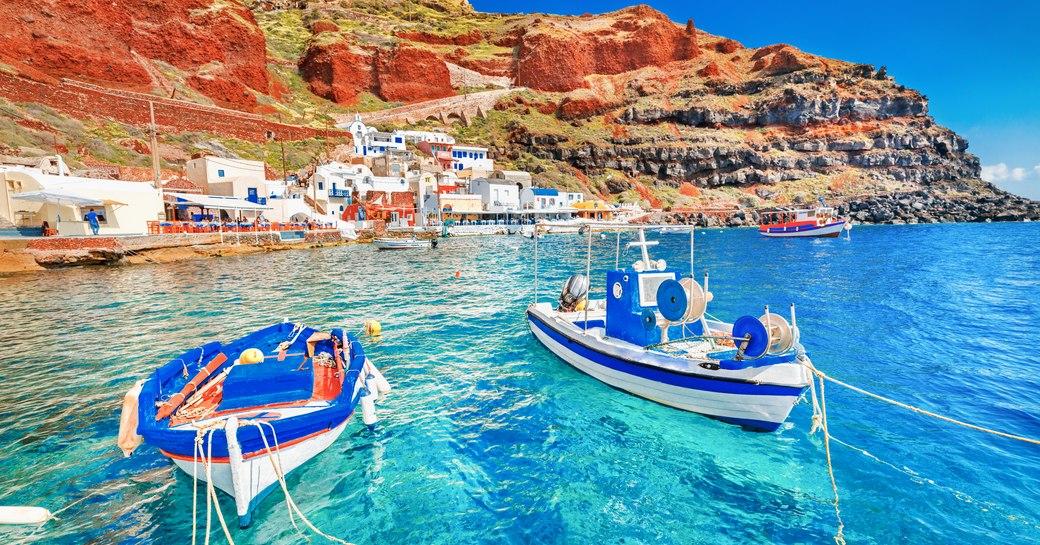 Boats docked in Santorini's blue waters
