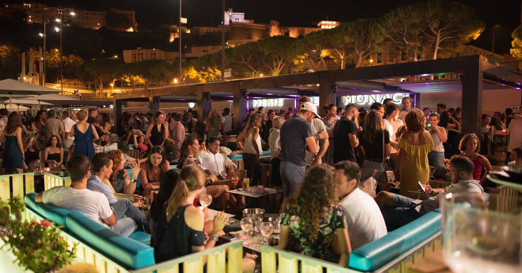 people at tables on outdoor terrace of brasserie de monaco