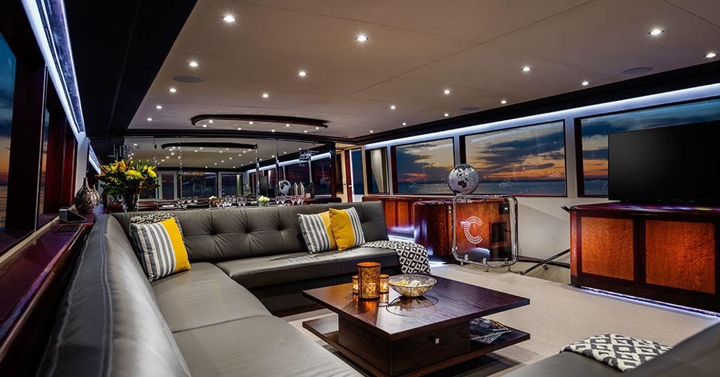 large sofa in main salon of motor yacht CORROBOREE