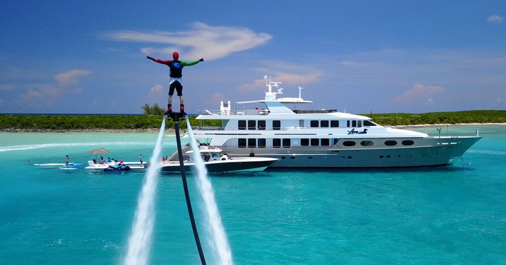 Man on water toy high above superyacht ZEAL