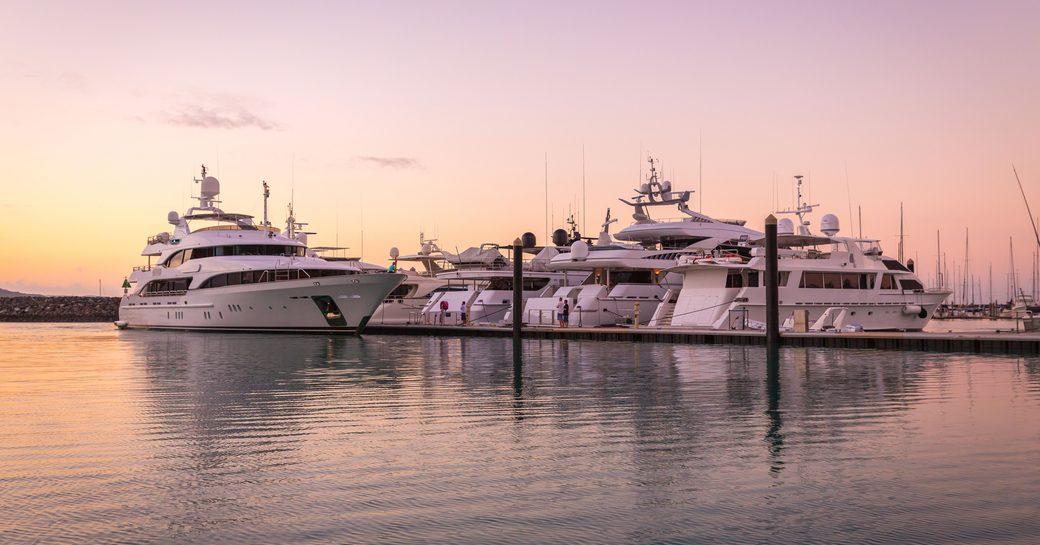 Sunset over superyachts at Coral Sea Marina and Resort