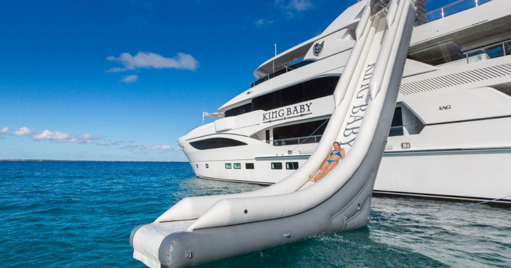 charter guest tries out the water slide on board motor yacht 'King Baby'