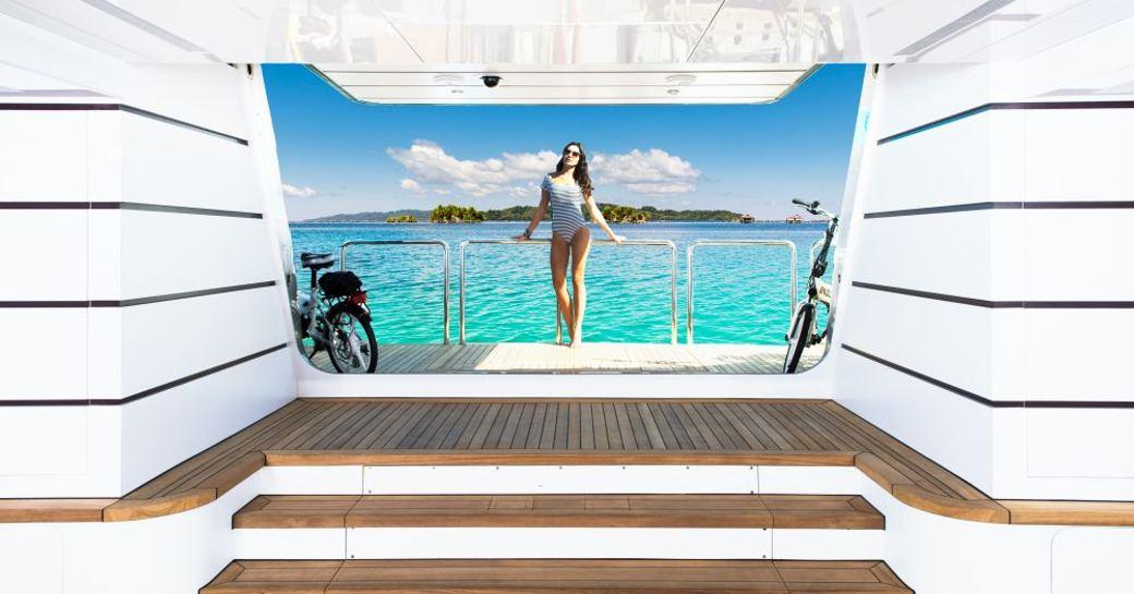 female guests on the swim platform of superyacht My Seanna