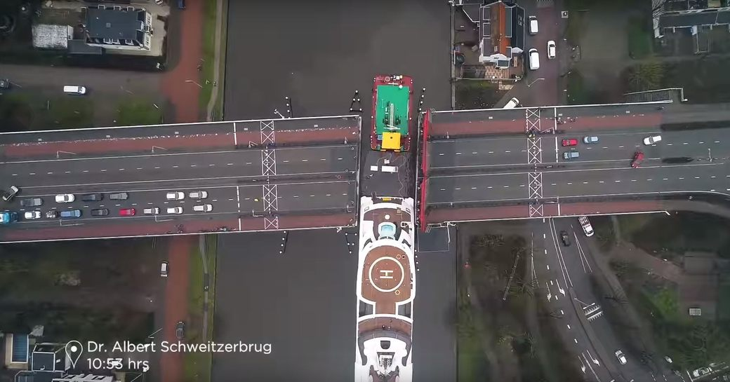 Charter yacht Lady fits through tight gap on bridge in waterway in Holland