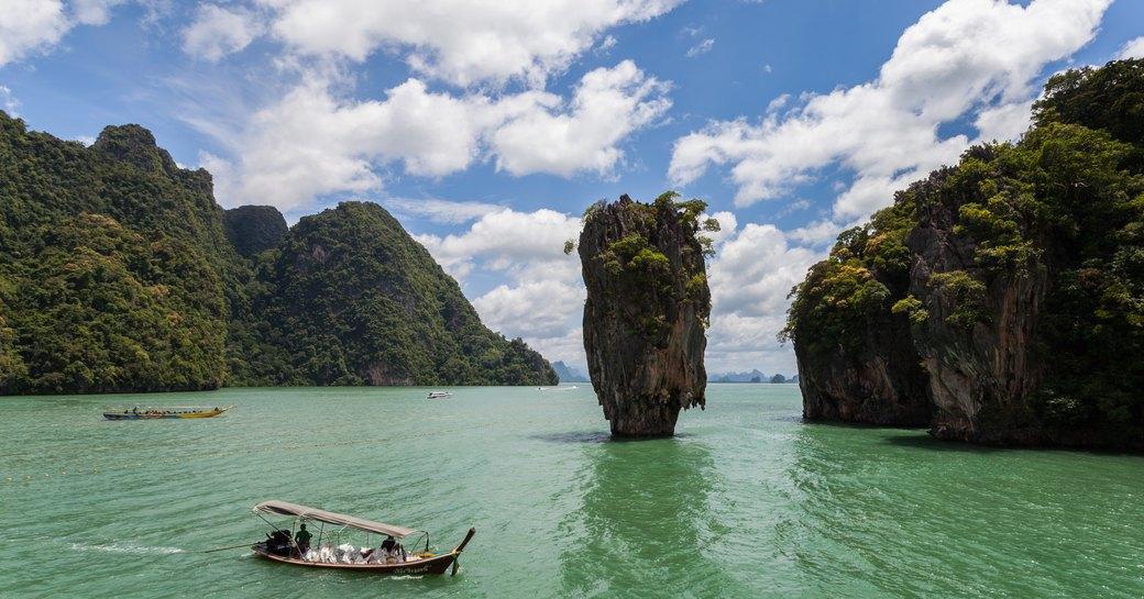 A canoe exploring Ao Phang-Nga National Park, Thailand