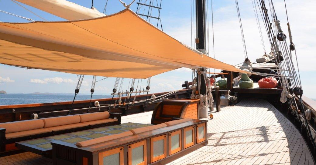 shaded seating area on the foredeck of charter yacht 'Dunia Baru'