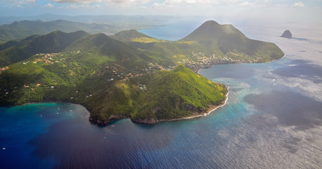 green-covered mountains and blue waters of Martinique in the Caribbean