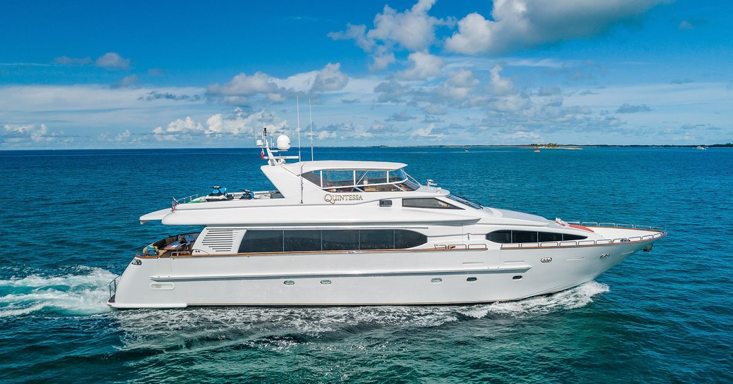 motor yacht quintessa underway on the clear turquoise waters of the Caribbean