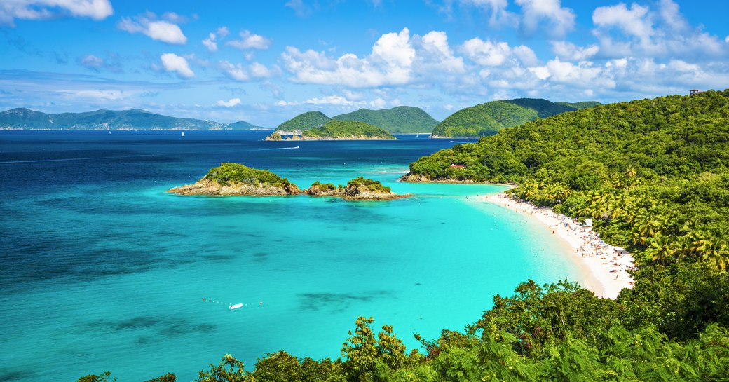 British Virgin Islands shot of clear blue sea, white sand beach and tropical forests