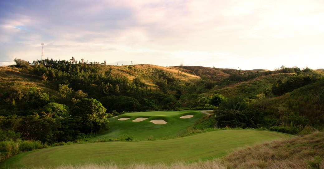 sun sets on Natadola Bay Championship Golf Couse in Fiji
