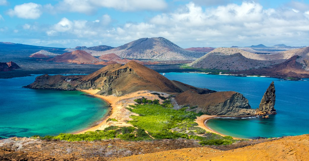 the Galapgos from the vantage points of one of the many mountains in the region where guests on a luxury yacht charter can expect to discover many rare species of animasl