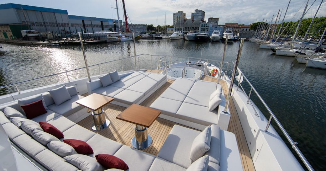 superyacht happy me foredeck area, with coffee tables and sunpads
