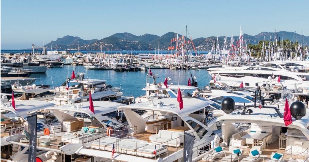 luxury yachts lined up in Vieux Port for the Cannes Yachting Festival
