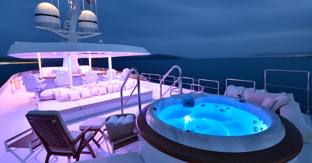 Charter yacht AZZURRA II sundeck, with illuminated jacuzzi pool and seating areas