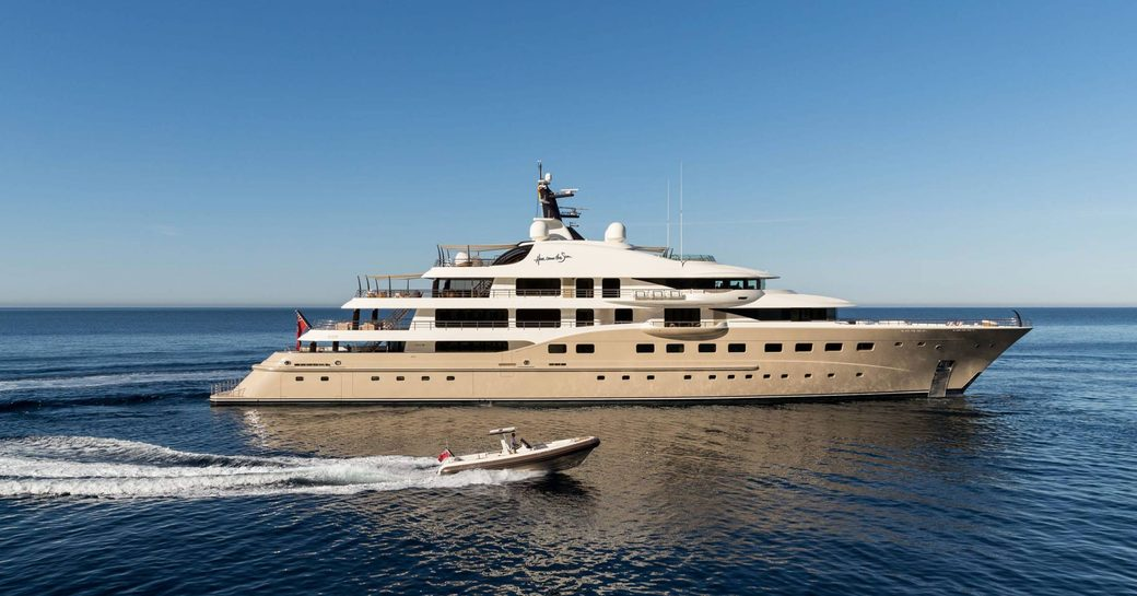 Luxury yacht Here Comes the Sun with tender