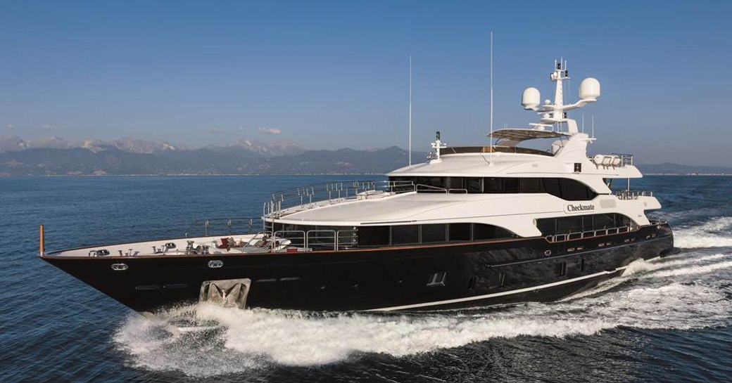 Profile shot of superyacht CHECKMATE on the water
