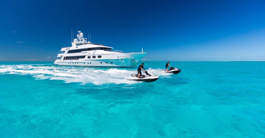 Superyacht cruising with two Jetskis