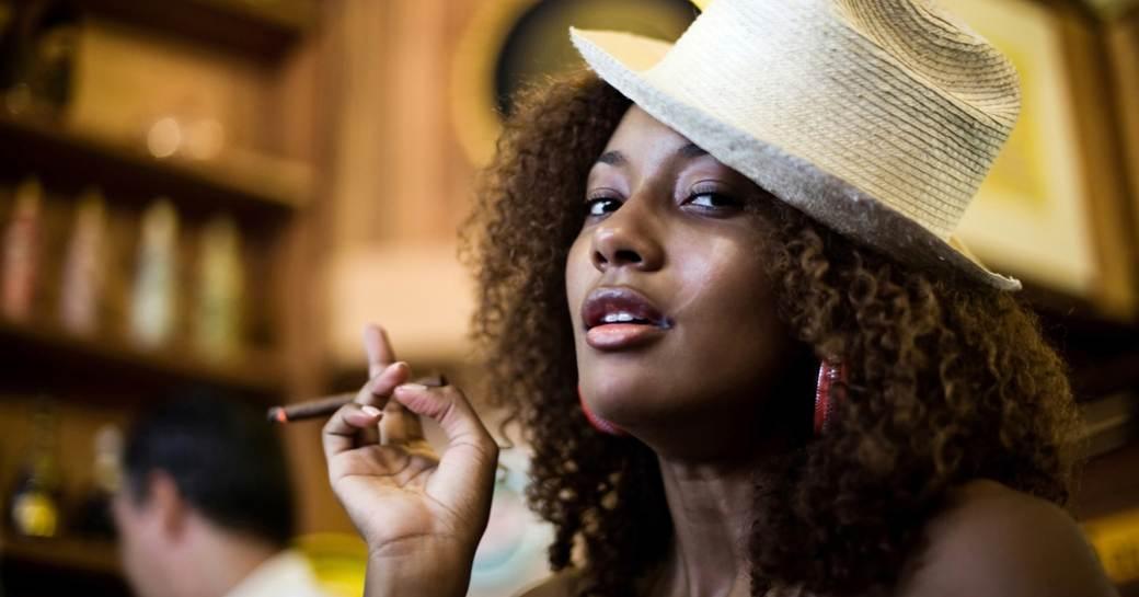 A woman enjoying a Cuban cigar