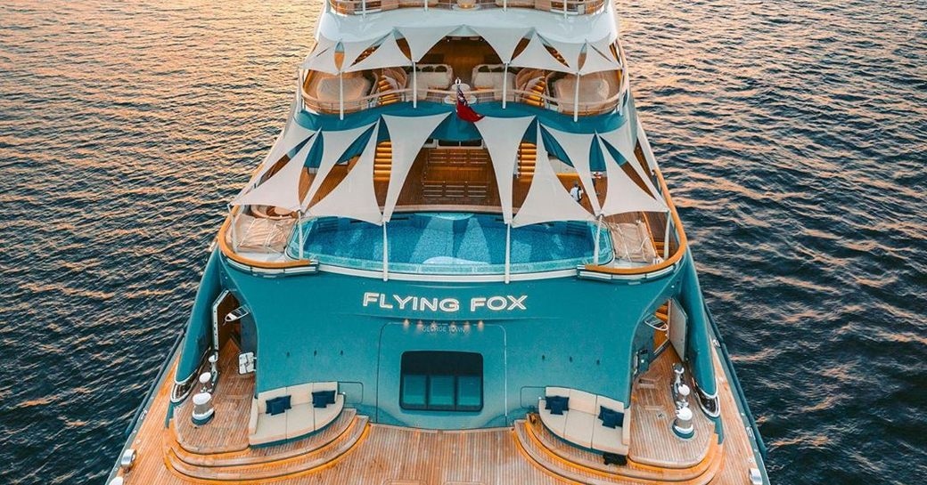 Arial shot of luxury yacht Flying Fox at anchor with pool on deck