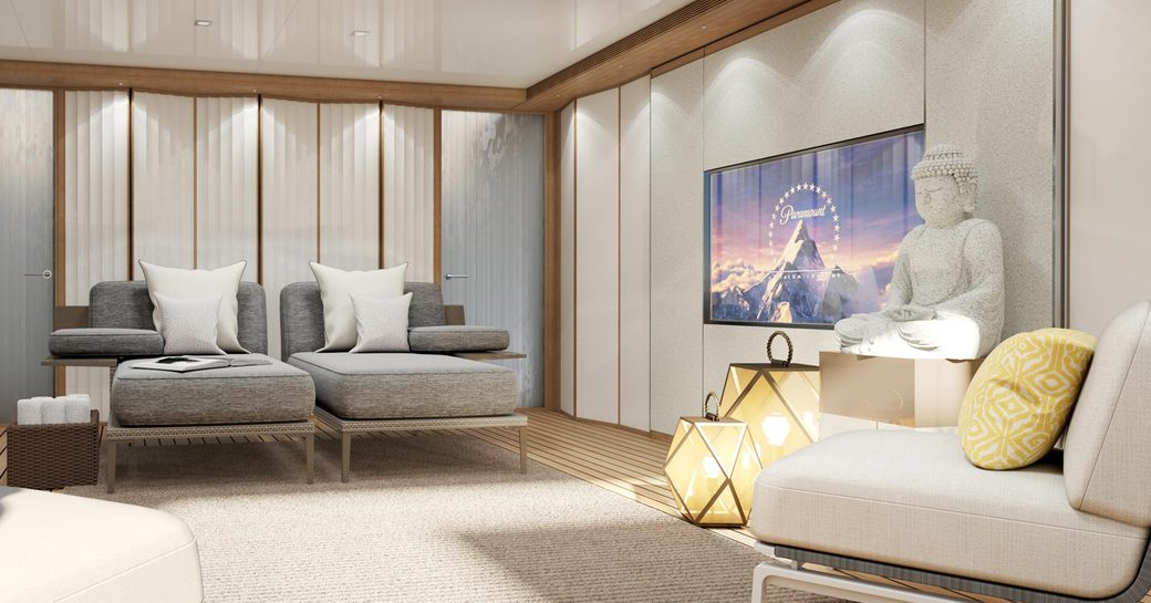 interior styling on heesen yacht moskito, with buddha statue and large tv screen
