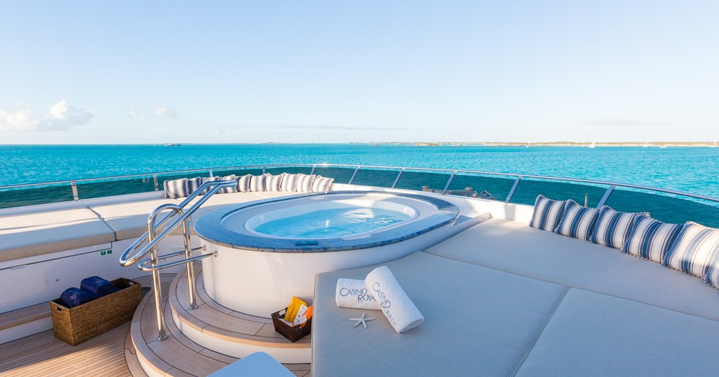 A Jacuzzi fixed on board a superyacht with blue ocean in the background