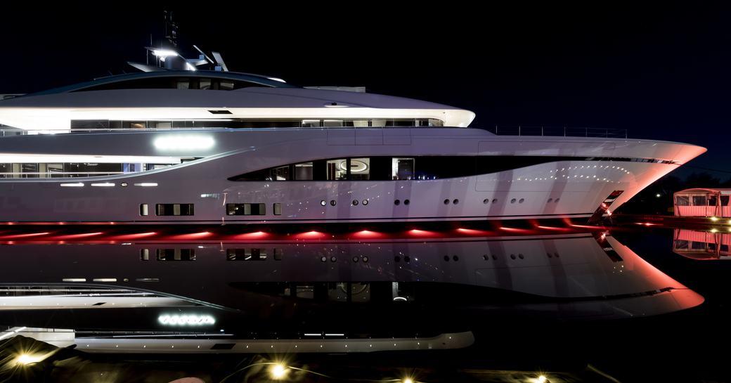 Feadship yacht ARROW at night