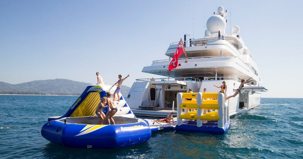 Charter guests playing on yacht Titania's waterpark
