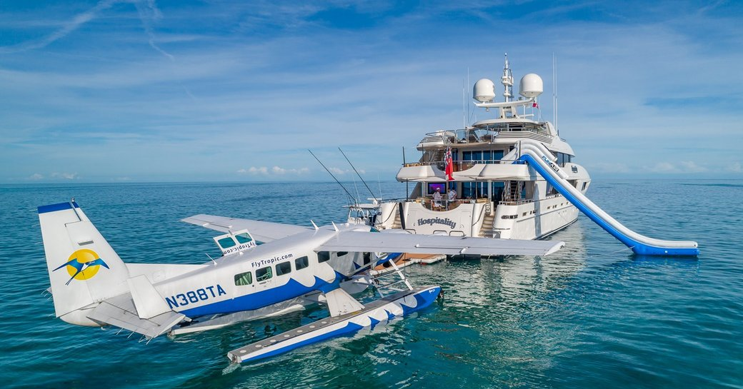 private plane arriving to yacht for yacht charter during social distancing