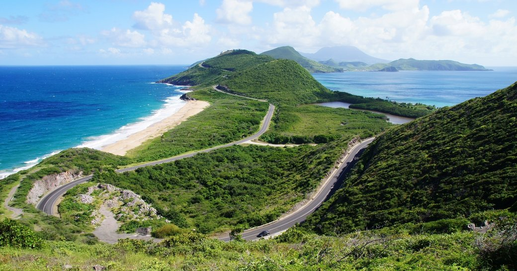 Scenic view from elevated overlook towards St. Kitts isthmus and Nevis Island, St. Kitts