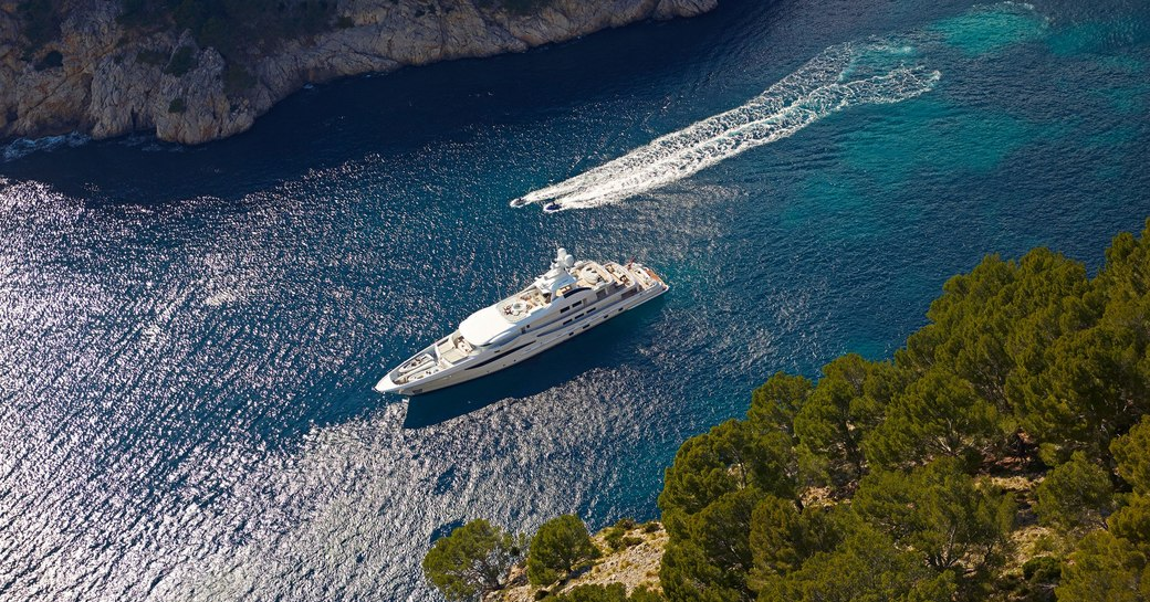 aerial image of superyacht spirit at anchor in small bay in greece