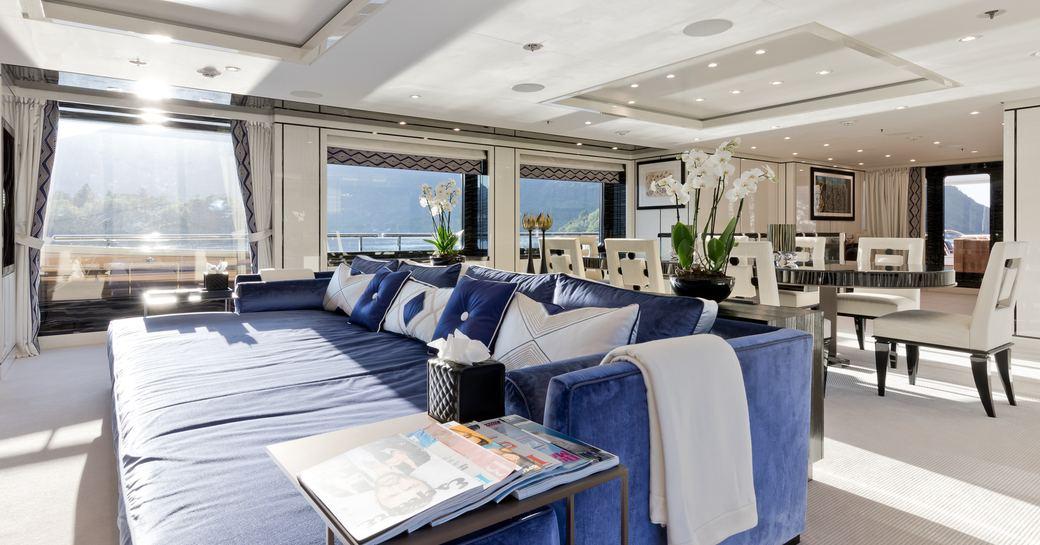 oversized sofa in the stylish main salon aboard superyacht LILI