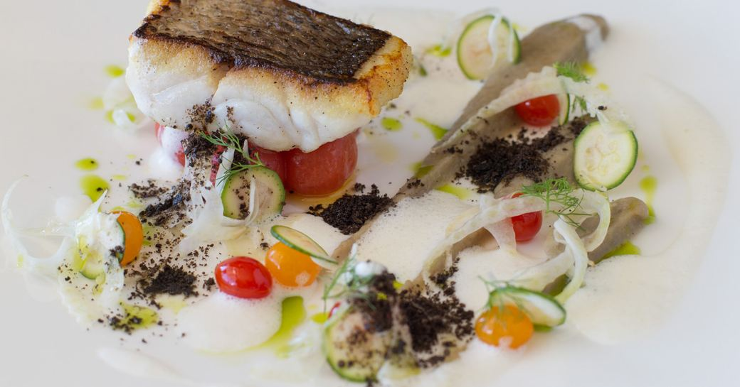 cuisine on superyacht, fish and white sauce