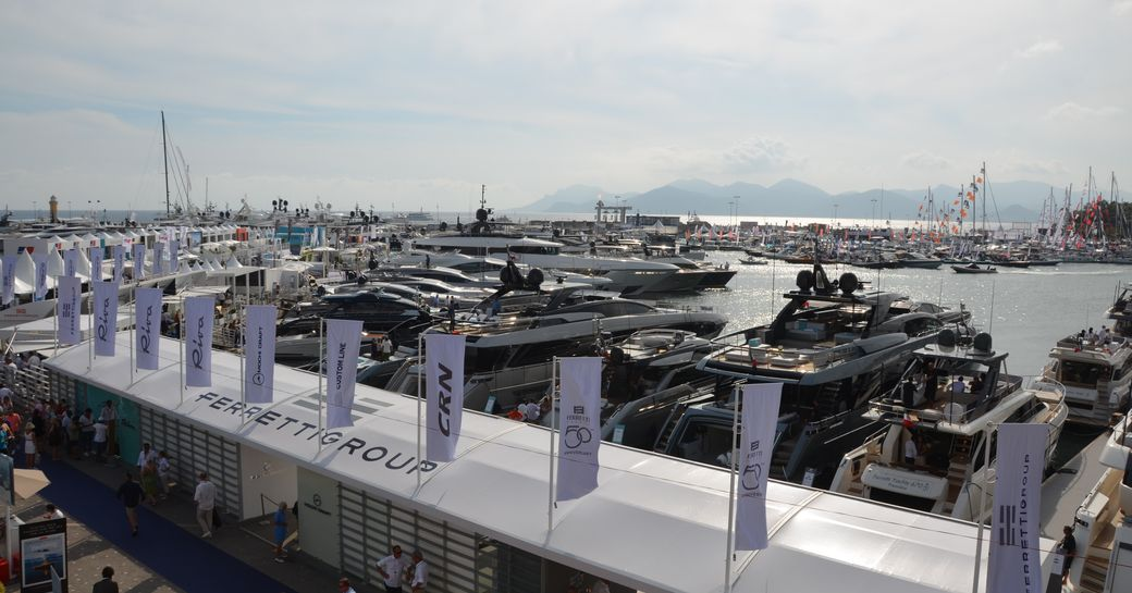 Luxury yachts lined up along the marina in cannes