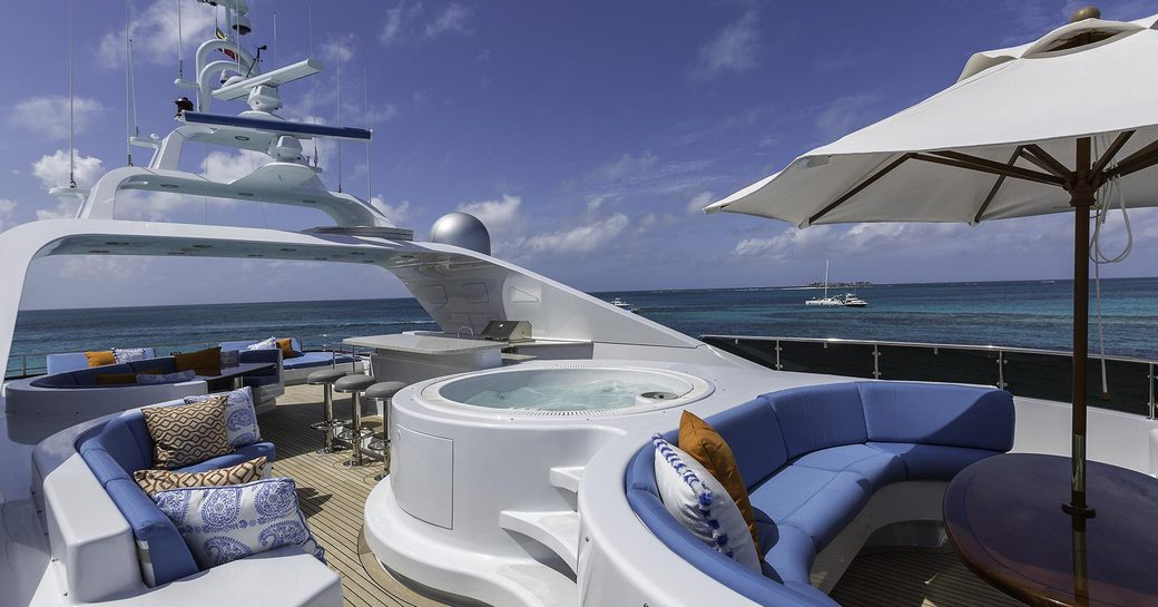 sundeck with Jacuzzi, bar and seating area on board superyacht M3