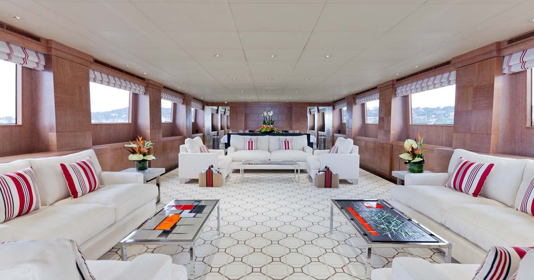 Main salon on motor yacht ELEMENT, with tall windows and cream colours
