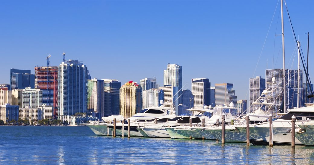 yachts lined up in Miami South Beach Marina with city skyline in the background