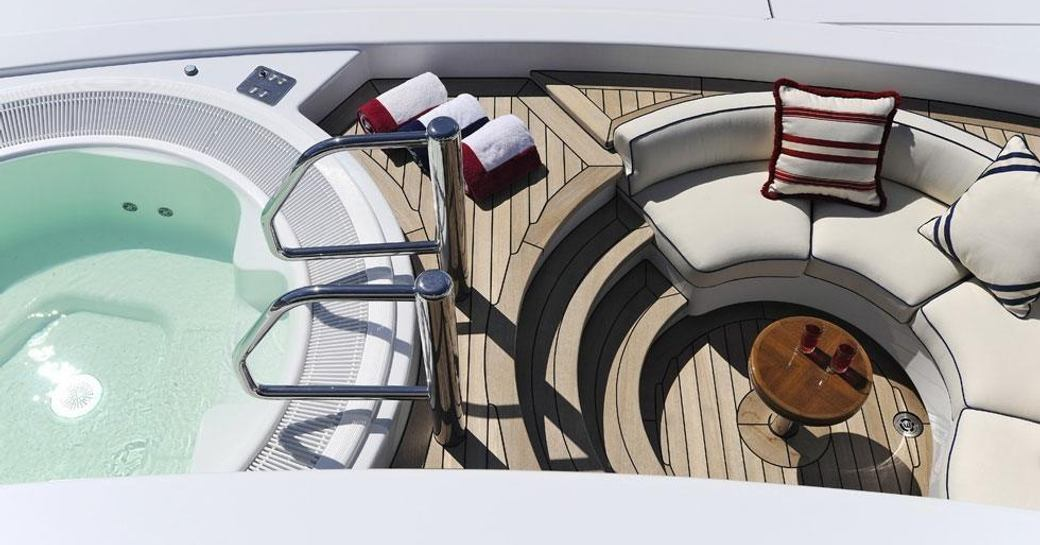 The Jacuzzi and outdoor seating available on luxury yacht TV