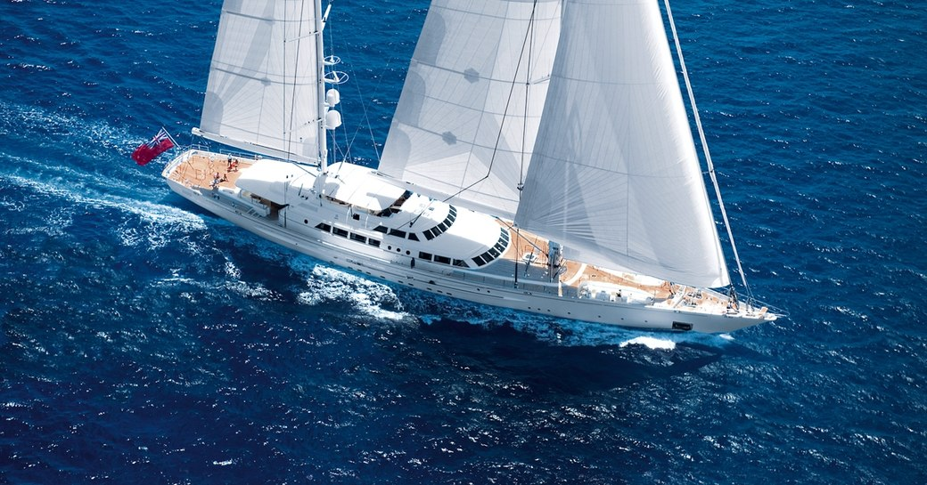 Running shot of large ketch yacht for charter