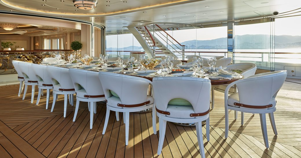 Aft deck dining set-up on luxury yacht TIS