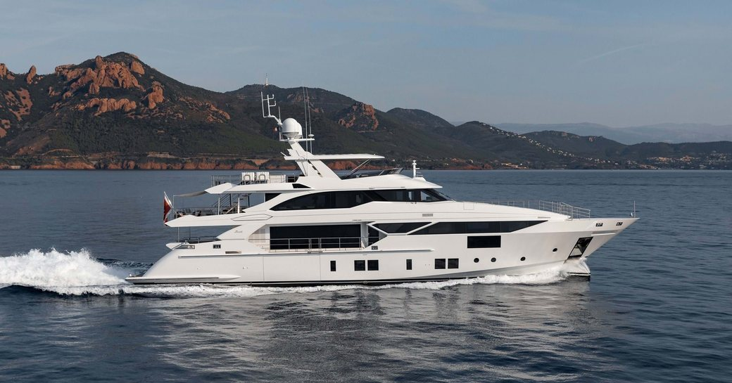 benetti superyacht Fast 145 underway with views over Italy in background