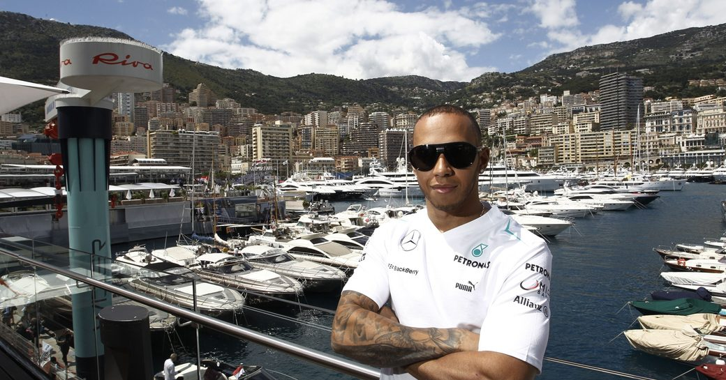 Lewis Hamilton in Monaco standing in front of harbour