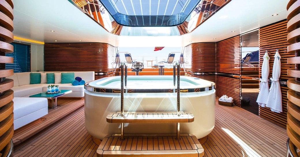 Indoor jacuzzi in beach club of sailing yacht AQUIJO