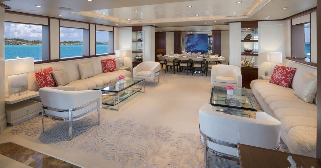 large sofas and armchairs form sociable seating area in the main salon of superyacht Time For Us