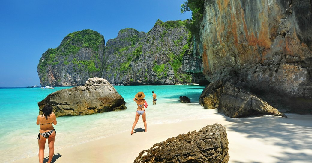 sunbathers on Maya Bay, Andaman Sea, Thailand