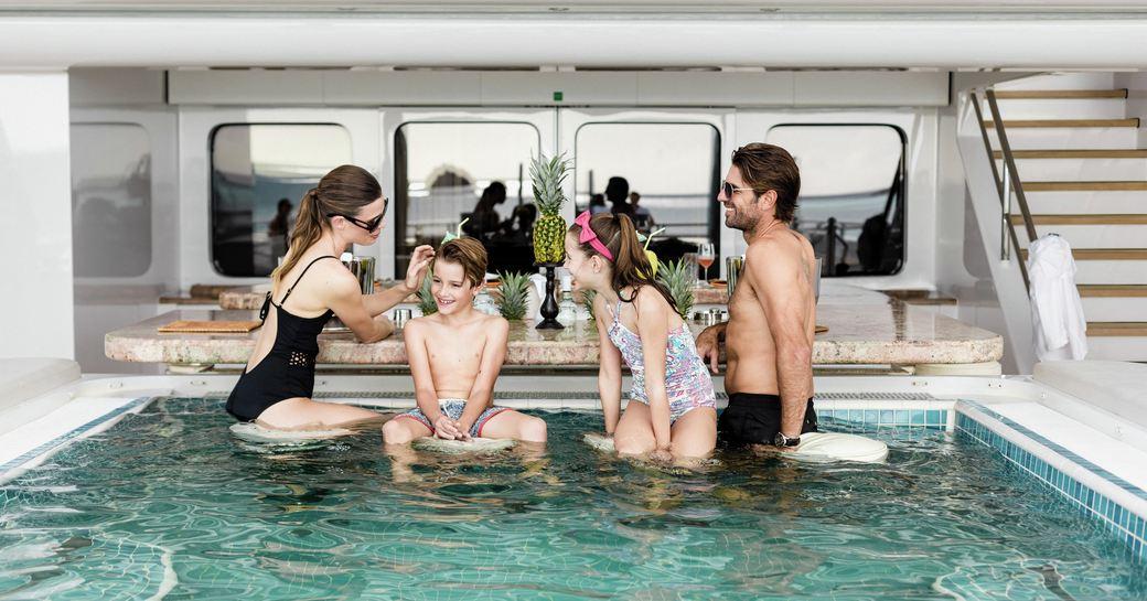 swim up bar in pool on upper deck of lurssen superyacht titania