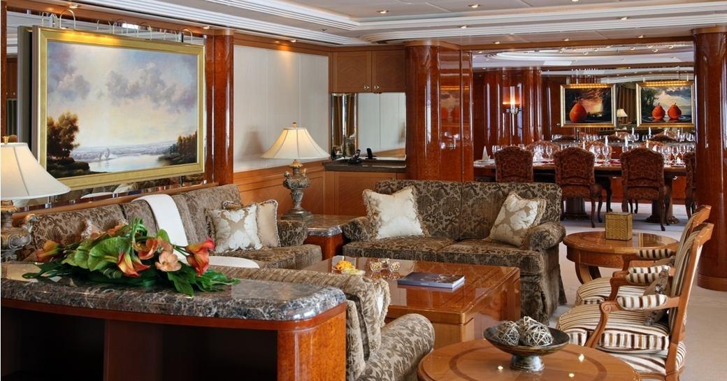 high gloss anigre and maple burl main salon on board luxury yacht CAPRI