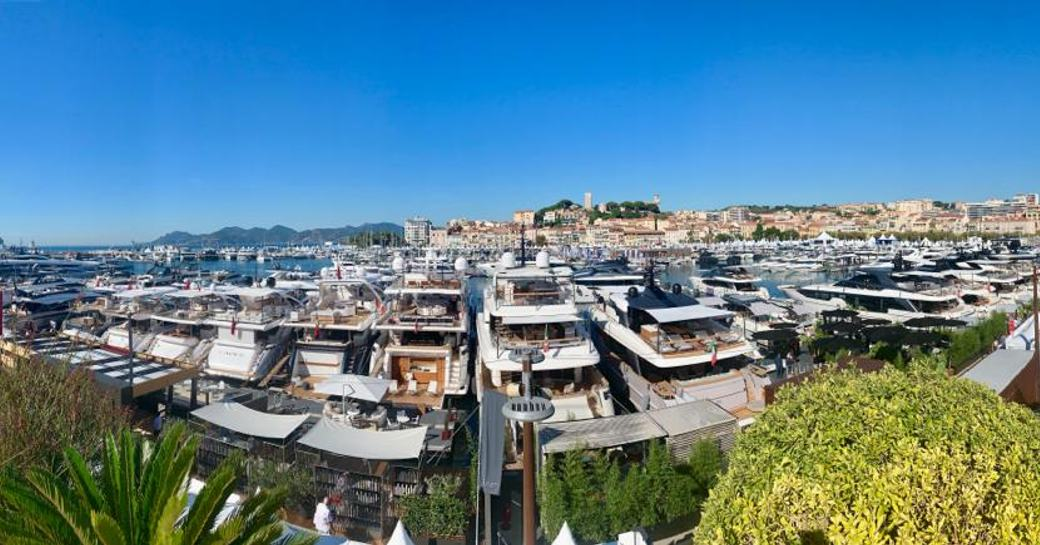 Yachts lined up along the harbour at Cannes Yachting Festival 2019