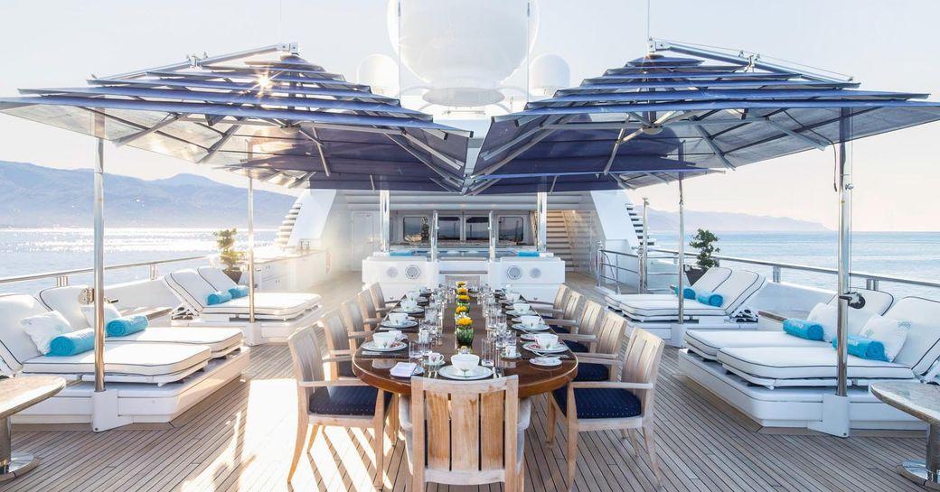 alfresco dining setup on upper deck aft of luxury yacht TITANIA