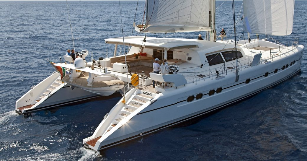 Profile of catamaran Orion while on charter with bow shown