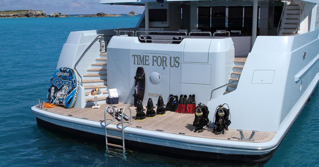 water toys lined up on the swim platform of superyacht Time For Us